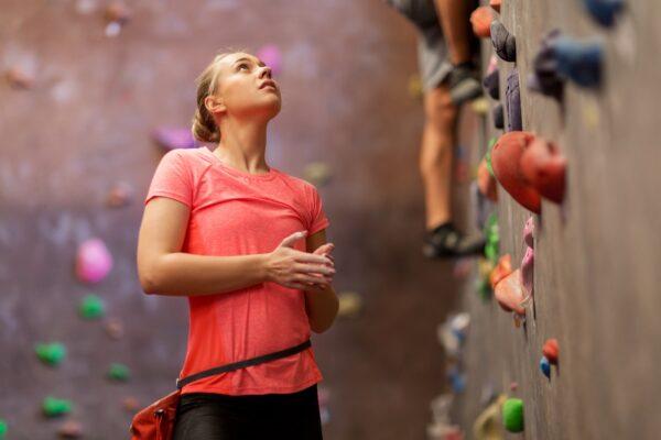 young woman exercising at indoor climbing gym